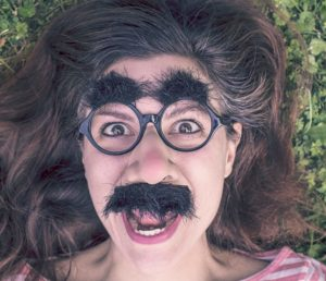 girl-with-eyebrows-and-mustache-disguise